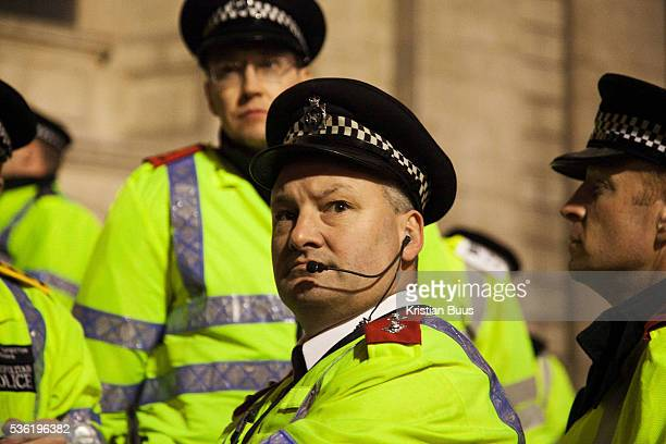 A senior Met police officer surveying the square from the steps The London Stock Exchange was attempted occypied in solidarity with Occupy Wall in...