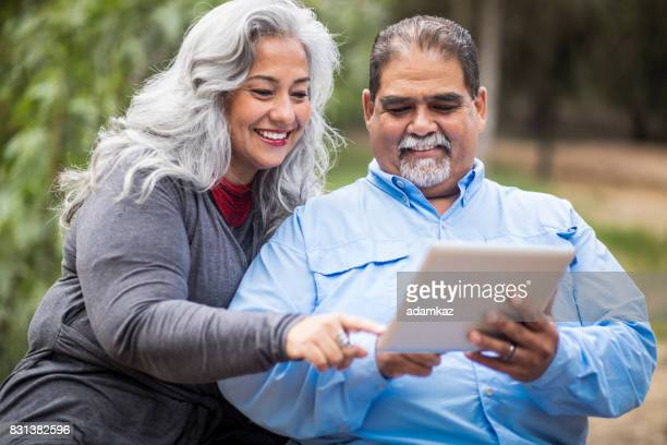 Senior Mexican Couple Using Tablet