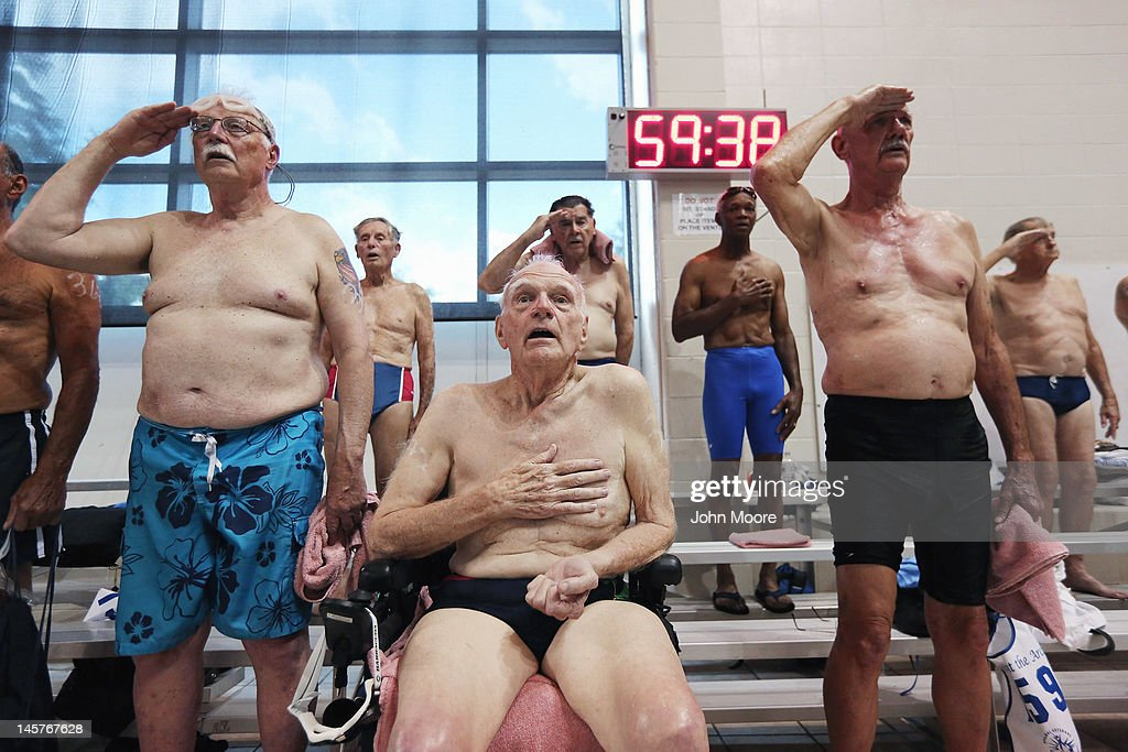 Senior military veterans, including World War II veteran Wayne Field, 86, (C), sing the national anthem before the swimming competition at the National Golden Age Games on June 4, 2012 in St Peters, Missouri. Almost 800 veterans between the ages of 55 and 101 from around the United States participated in the annual six-day event held by the Departement of Veterans Affairs this year in the St Louis area. The veterans competed in a wide range of sporting and recreational events, from swimming to dominoes, many of which were qualifying events for the 2013 National Senior Games.