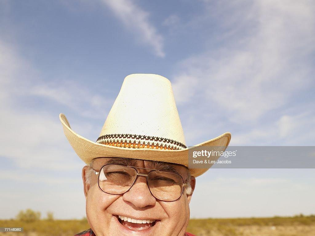 Senior Mixed Race man wearing straw hat