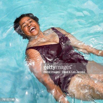 Senior Mixed Race woman in swimming pool