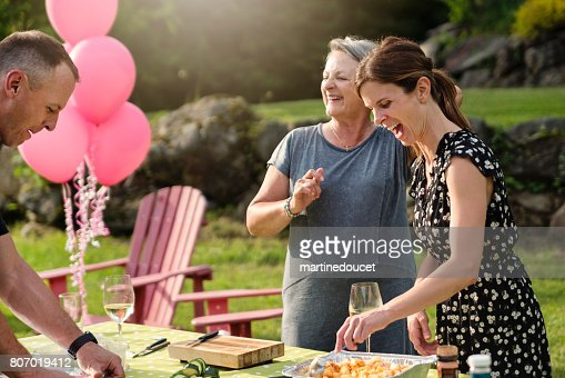 Senior mother and adult daughter having a drink at happy hour. : Stock Photo