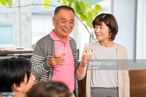 Senior mother and father drinking wine or proposing a toast