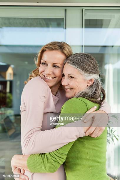 Senior mother and her daughter hugging