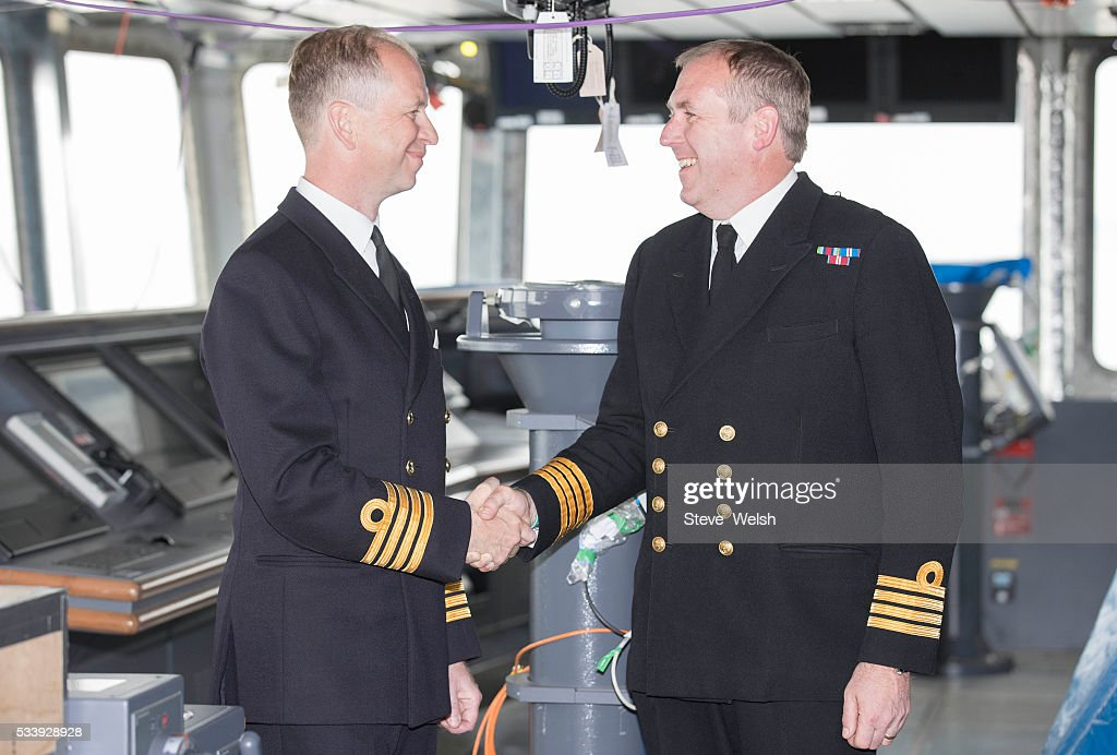 Senior Naval Officer, Captain Simon Petitt (R) hands over to the first seagoing Captain of HMS Queen Elizabeth, Captain Jerry Kyd (L), on the Bridge of the Royal Navy's new aircraft carrier on May 24, 2016 in Rosyth, United Kingdom. The Captain will lead men and women who will operate the 65,000 tonne flagship aircraft carrier for the Royal Navy. She is expected to be in commission from 2017.