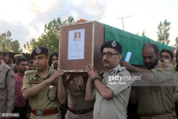 Senior officials including IG police shouldering the coffin of a slain police man killed in Kulgam Seven persons including five policemen and two...