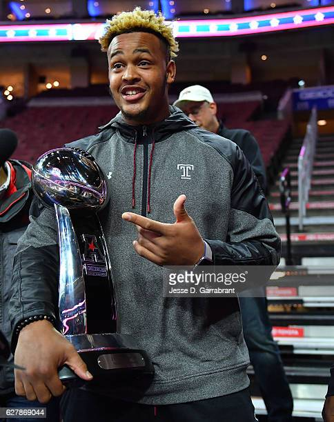 Senior OL Dion Dawkins of the Temple Owls poses with a conference trophy prior to the Philadelphia 76ers against the Denver Nuggets at Wells Fargo...