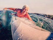 Senior on a surfboard