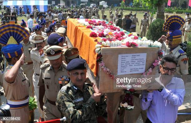 Senior paramilitary officers carry the coffins containing the body of slain paramilitary Central Reserve Police Force SubInspector Sahab Shukla...