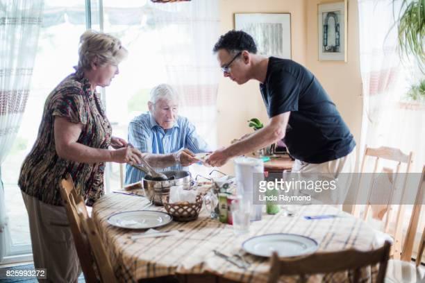 Senior parents and son having dinner