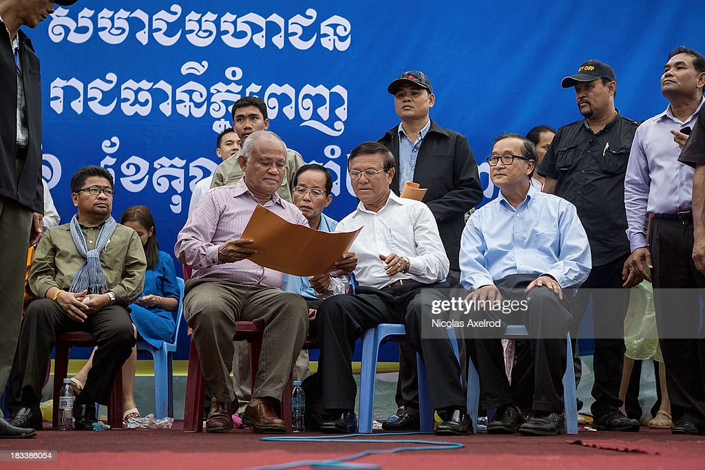 Senior party member Pol Hom, Kem Sokha party Vice-President,and <a gi-track='captionPersonalityLinkClicked' href=/galleries/search?phrase=Sam+Rainsy&family=editorial&specificpeople=660347 ng-click='$event.stopPropagation()'>Sam Rainsy</a> party President before addressing supporters of the Cambodia National Rescue party in Freedom Park on October 6, 2013 in Phnom Penh, Cambodia. Cambodian Opposition party supporters gathered to petition the United Nations to intervene following disputed Cambodian elections in September that lead to days of protests.