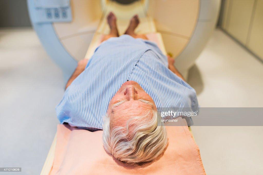 Senior patient receiving an MRI Scan.