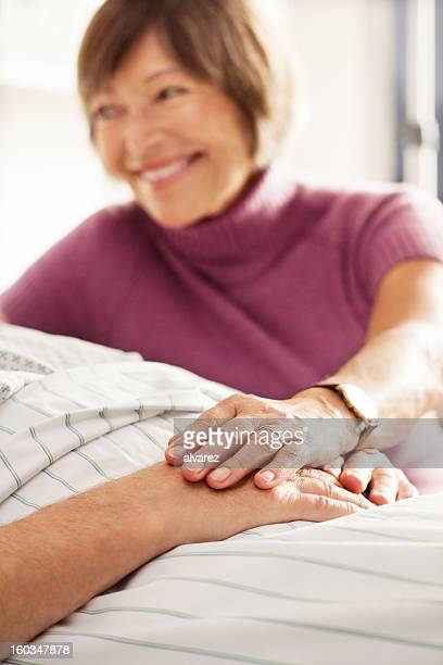 Senior patient taken care of by his wife