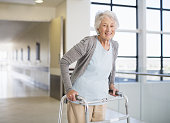 Senior patient using walker in hospital