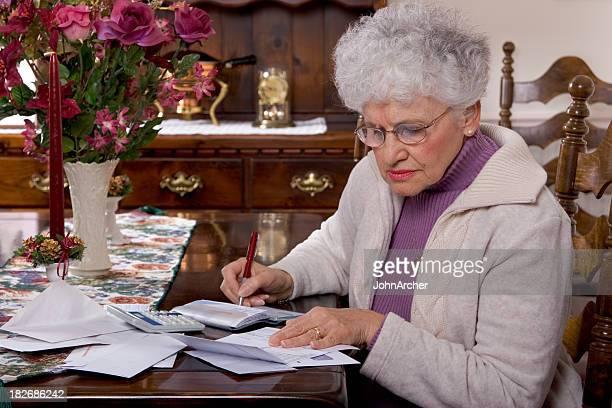 Senior Paying the Bills