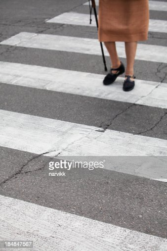 Senior pedestrian walking over the street
