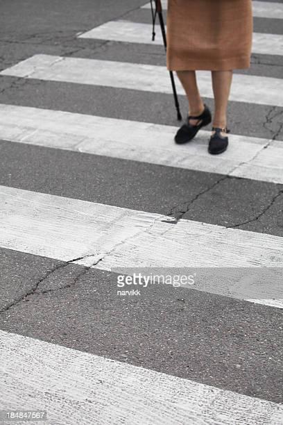 Senior pedestrian walking over the street