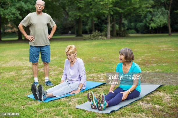 Senior people doing exercise in park