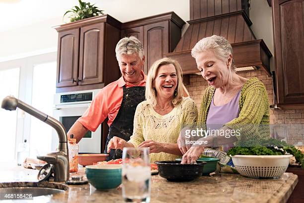 Senior people having fun in the kitchen