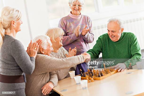Senior people playing chess