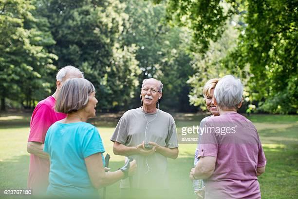 Senior people taking a break from exercising