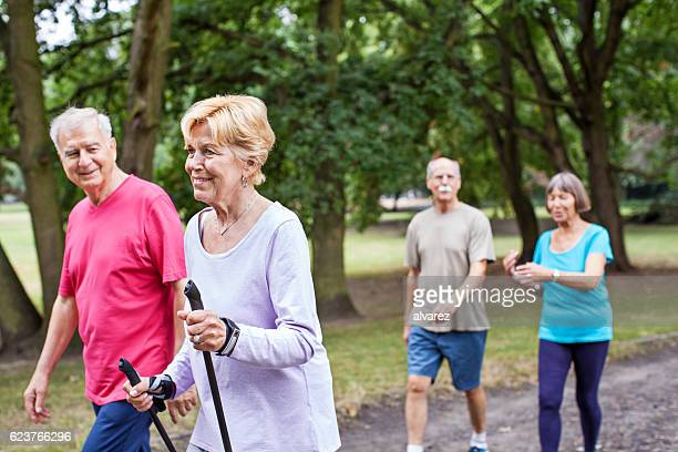 Senior people walking in a park
