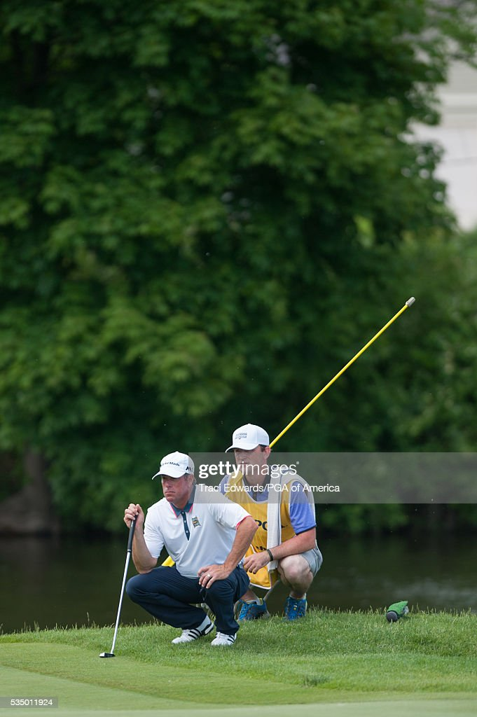 Senior PGA Club Professional, John DalCorobbo and his caddie read his putt during the third round for the 77th Senior PGA Championship presented by KitchenAid held at Harbor Shores Golf Club on May 28, 2016 in Benton Harbor, Michigan.