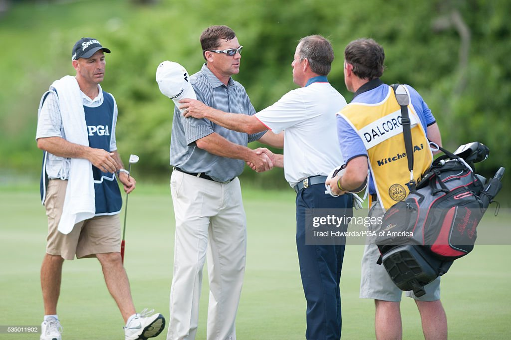 Senior PGA Club Professional, John DalCorobbo shakes hands with <a gi-track='captionPersonalityLinkClicked' href=/galleries/search?phrase=Brandt+Jobe&family=editorial&specificpeople=2292387 ng-click='$event.stopPropagation()'>Brandt Jobe</a> on the 18th hole during the third round for the 77th Senior PGA Championship presented by KitchenAid held at Harbor Shores Golf Club on May 28, 2016 in Benton Harbor, Michigan.