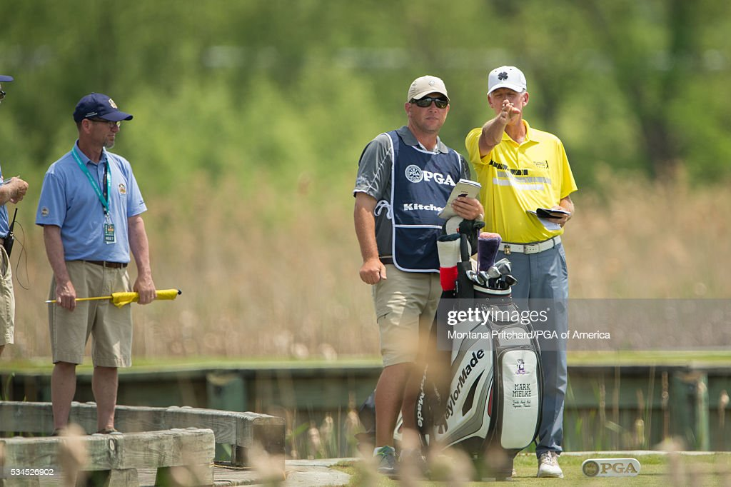 Senior PGA Club Professional, Mark Mielke speaks with his caddie during the first round for the 77th Senior PGA Championship presented by KitchenAid held at Harbor Shores Golf Club on May 26, 2016 in Benton Harbor, Michigan.