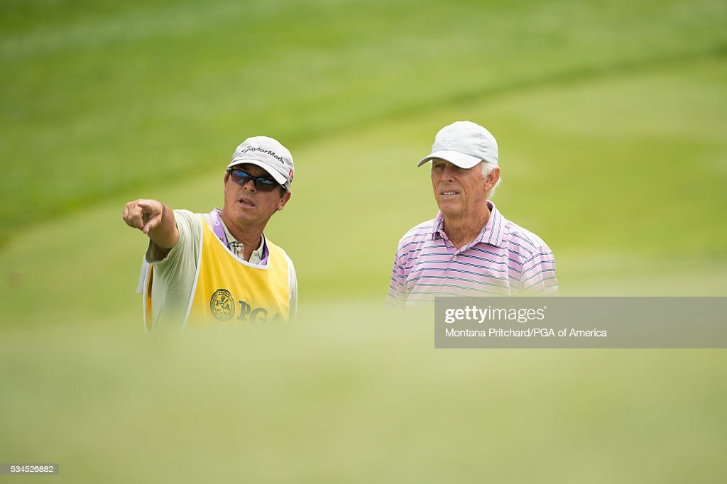 Senior PGA Club Professional, Mike San Filippo speaks with his caddie during the first round for the 77th Senior PGA Championship presented by KitchenAid held at Harbor Shores Golf Club on May 26, 2016 in Benton Harbor, Michigan.