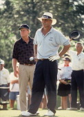 Senior PGA golfer Tom Wargo eyes the tee shot as golfing legend Jack Nicklaus looks on Palm Beach Gardens FL 1996