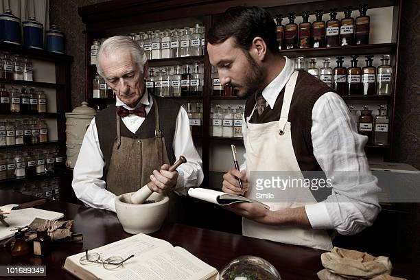 Senior pharmacist teaching his apprentice