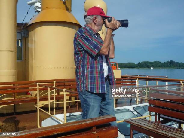 Senior photographed from the deck of paddlewheel steamers 'Ludwig Fessler' at the Chiemsee, Bavaria - Germany