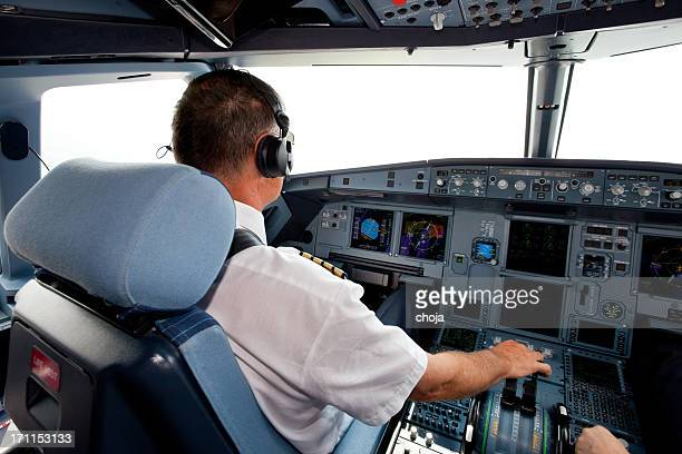 Senior pilot in the cockpit during a commercial flight