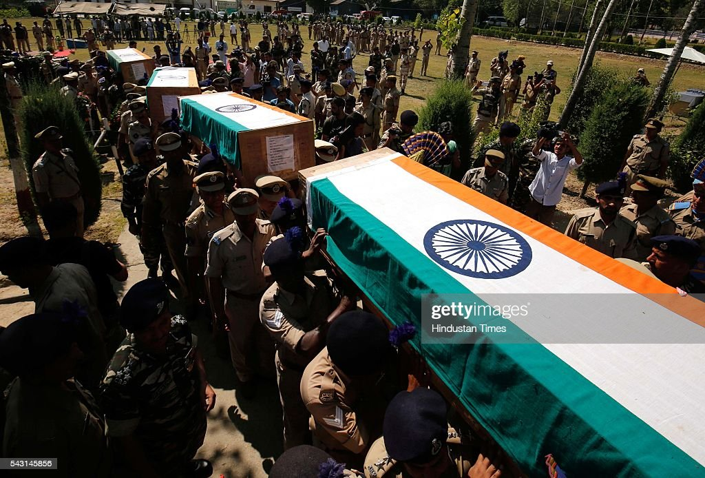 Senior police and paramilitary officers carry the coffin containing the bodies of slain Central Reserve Police Force (CRPF) men who had lost their lives in an encounter with Lashkar terrorists in Pampore during a wreath laying ceremony on the outskirts of Srinagar, on June 26, 2016 in Srinagar India. Eight Central Reserve Police Force men were killed and 20 others injured after militants ambushed a convoy of the security force on the Srinagar-Jammu national highway in Jammu and Kashmir's Pulwama district. Two militants were also killed in the gunfight, the second major attack on a security convoy this month.