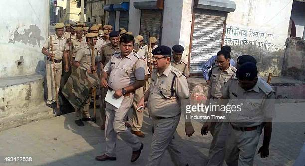 Senior Police officials during an investigation after two young children from a Dalit family who were burnt alive last night after their home was...