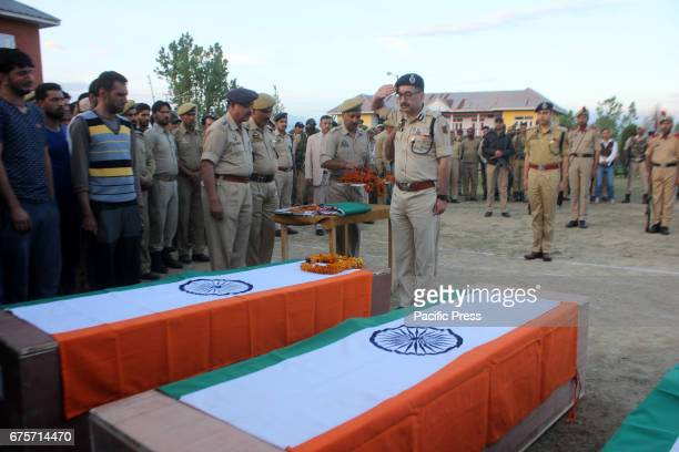 Senior Police officials pay last respect to slain cops during wreath laying ceremony at Kulgam Seven persons including five policemen and two bank...
