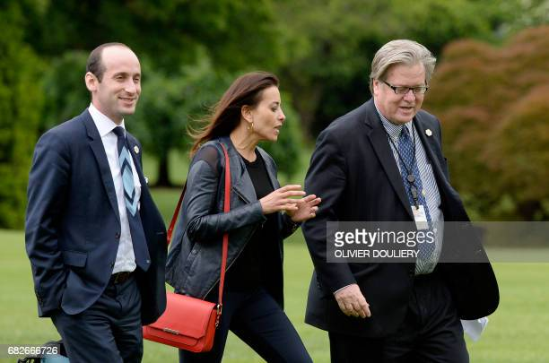 Senior policy adviser Stephen Miller Deputy National Security adviser Dina Powell and strategist Steve Bannon exit Marine One on the South Lawn of...