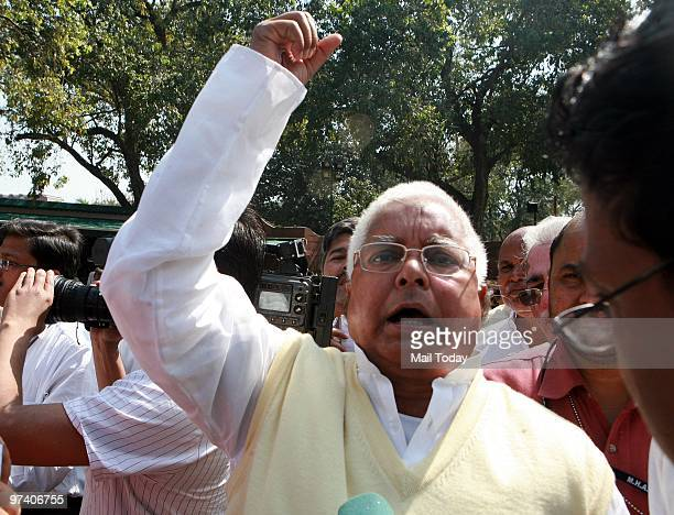 Senior political leader Lalu Prasad Yadav addresses the media after the opposition leaders walked out of the parliament house to protest against the...