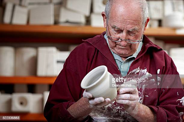 Senior potter working on a clay vase