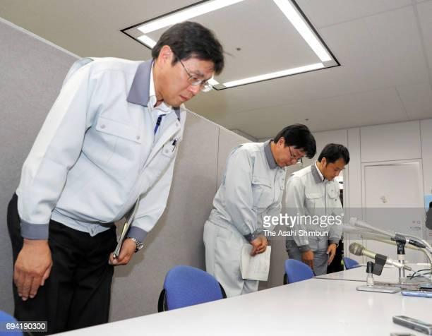 Senior principal scientist in Fast Reactor Fuel Technology Development Department of Japan Atomic Energy Agency Masato Kato bows during a press...