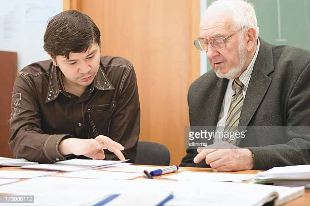 Senior professor discusses an issue with a student
