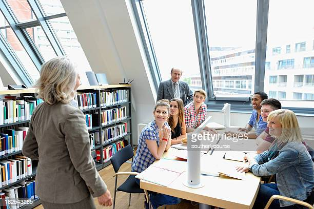 Senior Professors Holding Lecture in Library