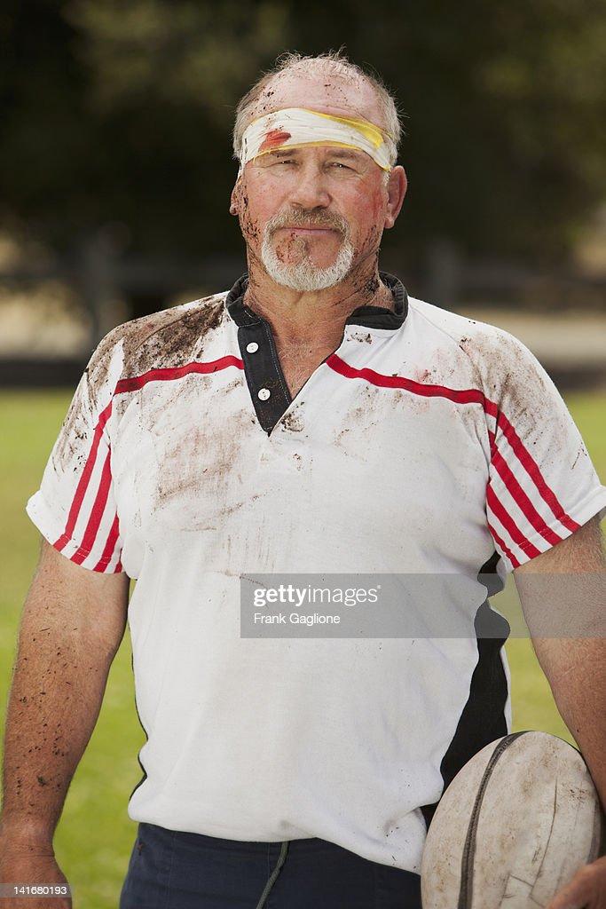 Senior rugby player posing. : Stock Photo