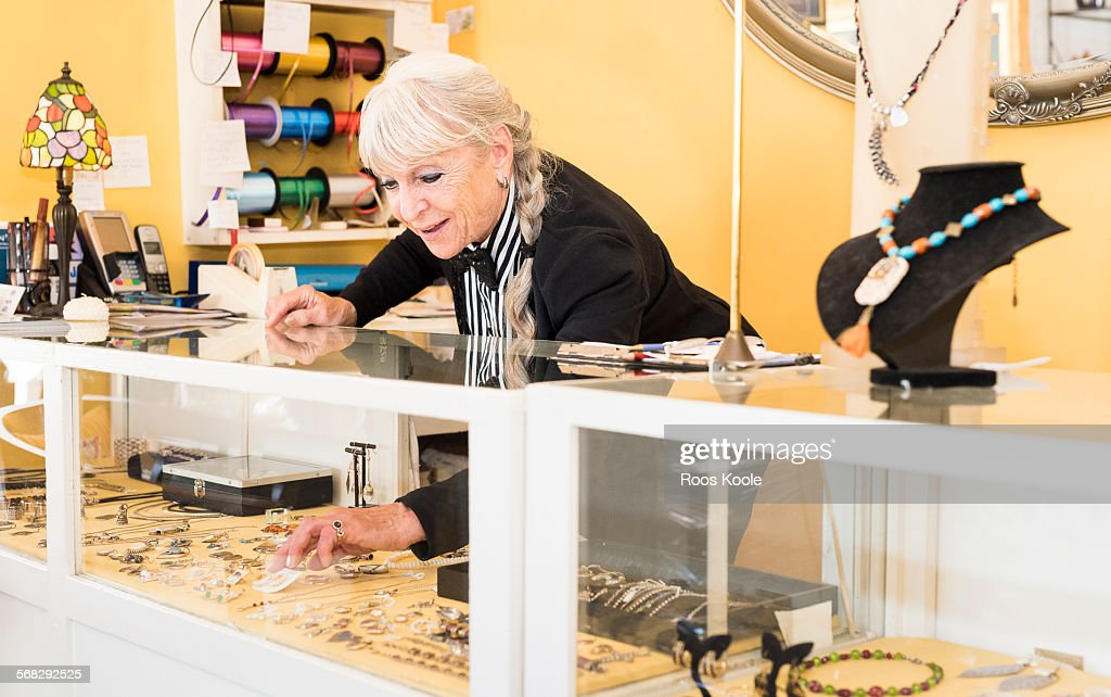 A senior shop owner in a gift shop