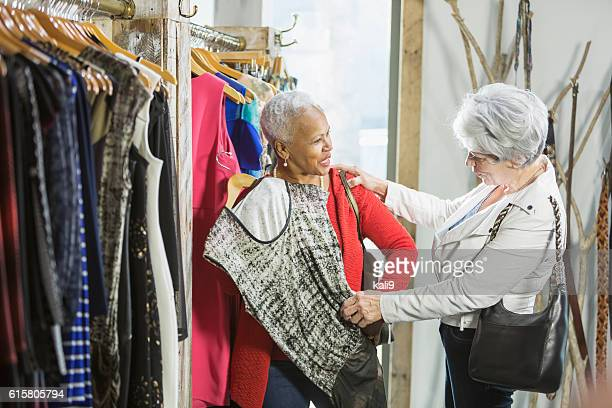 Senior shoppers in a clothing store looking at rack