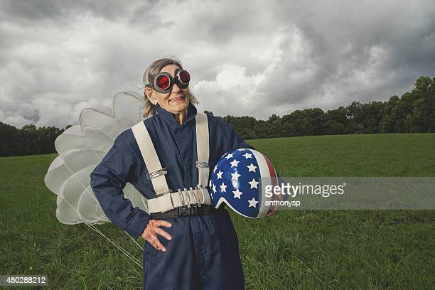 senior skydiver with helmet and parachute