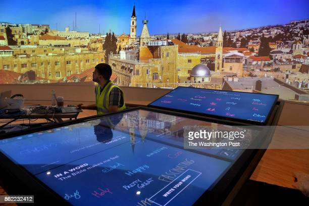 Senior Software Developer Donnie Richardson is still doing testing at the area where visitors can write on a large interactive tablet table Those...