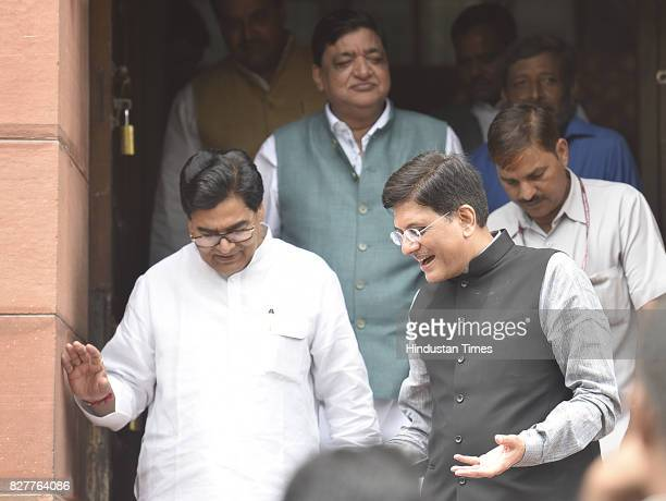 Senior SP leader Ram Gopal Yadav Naresh Aggarwal with BJP leader Piyush Goyal leaving the Monsoon Session at Parliament House on August 8 2017 in New...