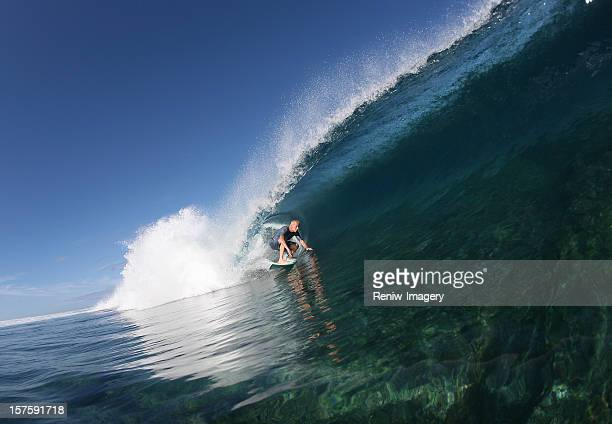 Senior surfer surfing